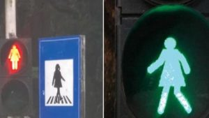 female icons on traffic signals